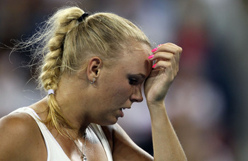 NEW YORK, NY - SEPTEMBER 05:  Caroline Wozniacki of Denmark wipes sweat from her face against Svetlana Kuznetsova of Russia during Day Eight of the 2011 US Open at the USTA Billie Jean King National Tennis Center on September 5, 2011 in the Flushing neigh