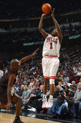 CHICAGO - MARCH 9:  Jamal Crawford #1 of the Chicago Bulls shoots over Aaron McKie #8 of the Philadelphia 76ers during the game at United Center on March 9, 2004 in Chicago, Illinois.  The 76ers won 89-81.  NOTE TO USER: User expressly acknowledges and ag