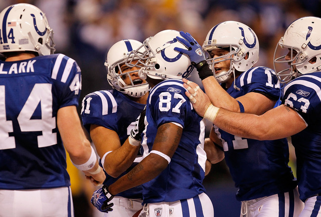 INDIANAPOLIS - JANUARY 16:  Reggie Wayne #87 of the Indianapolis Colts celebrates with teammates Austin Collie #17 and Donald Brown #31 after Wayne scored a three-yard touchdown in the second quarter against the Baltimore Ravens in the AFC Divisional Play