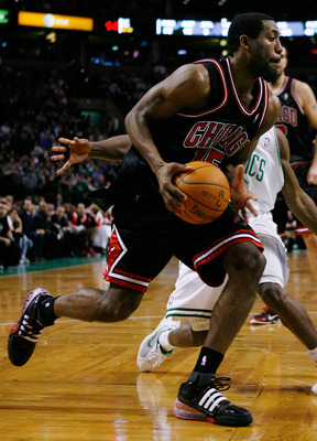 BOSTON - JANUARY 14:  John Salmons #15 of the Chicago Bulls drives past Rajon Rondo #9 of the Boston Celtics at the TD Garden on January 14, 2010 in Boston, Massachusetts. The Bulls defeated the Celtics 96-83. NOTE TO USER: User expressly acknowledges and