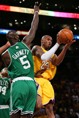 LOS ANGELES, CA - JUNE 12:  Kobe Bryant #24 of the Los Angeles Lakers passes the ball around Kevin Garnett #5 of the Boston Celtics in Game Four of the 2008 NBA Finals on June 12, 2008 at Staples Center in Los Angeles, California. NOTE TO USER: User expre