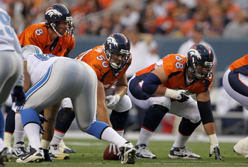 DENVER - AUGUST 21:  Rookie offensive linemen, center J D Walton #50 and guard Zane Beadles #68, prepare to protect quarterback Kyle Orton #8 of the Denver Broncos  against the Detroit Lions during preseason NFL action at INVESCO Field at Mile High on Aug