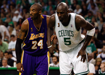 BOSTON - JUNE 08:  Kobe Bryant #24 of the Los Angeles Lakers stands alongside Kevin Garnett #5 of the Boston Celtics during a free throw in Game Two of the 2008 NBA Finals on June 8, 2008 at TD Banknorth Garden in Boston, Massachusetts. NOTE TO USER: User