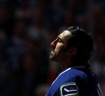 VANCOUVER, BC - JUNE 10:  Roberto Luongo #1 of the Vancouver Canucks looks on prior ot playing against the Boston Bruins in Game Five of the 2011 NHL Stanley Cup Final at Rogers Arena on June 10, 2011 in Vancouver, British Columbia, Canada.  (Photo by Bru