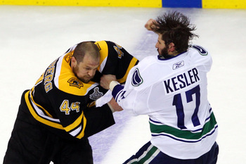 BOSTON, MA - JUNE 06:  Ryan Kesler #17 of the Vancouver Canucks fights with Dennis Seidenberg #44 of the Boston Bruins during Game Three of the 2011 NHL Stanley Cup Final at TD Garden on June 6, 2011 in Boston, Massachusetts.  (Photo by Bruce Bennett/Gett