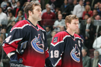 VANCOUVER - NOVEMBER 22:  Todd Bertuzzi #44 and Markus Naslund #19 of the Vancouver Canucks line up for introductions before the NHL game against the Chicago Blackhawks at General Motors Place on November 22, 2005 in Vancouver, Canada. The Canucks defeate
