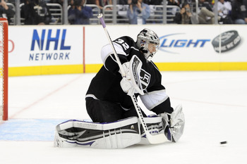 LOS ANGELES, CA - APRIL 25:  Jonathan Quick #32 of the Los Angeles Kings makes a save against the San Jose Sharks in the first period of game six of the Western Conference Quarterfinals during the 2011 NHL Stanley Cup Playoffs at Staples Center on April 2