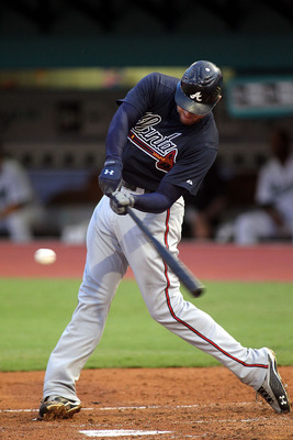 MIAMI GARDENS, FL - AUGUST 08: Freddie Freeman #5 of the Atlanta Braves drives in a run against the Florida Marlins at Sun Life Stadium on August 8, 2011 in Miami Gardens, Florida.  (Photo by Marc Serota/Getty Images)