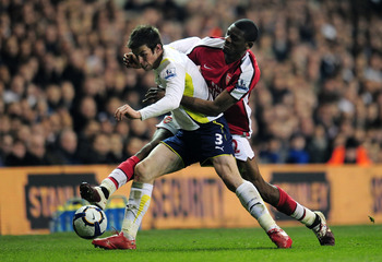 LONDON, ENGLAND - APRIL 14:  Abou Diaby of Arsenal challenges Gareth Bale of Tottenham Hotspur during the Barclays Premier League match between Tottenham Hotspur and Arsenal at White Hart Lane on April 14, 2010 in London, England.  (Photo by Shaun Botteri