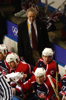 24 Feb 2002: Coach Herb Brooks of the USA stands behind his team during the mens ice hockey gold medal game at the Salt Lake City Winter Olympic at the E Center in Salt Lake City, Utah. Canada won the gold medal 5-2. DIGITAL IMAGE. Mandatory Credit: Doug