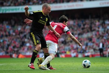 LONDON, ENGLAND - APRIL 17:  Jay Spearing of Liverpool tackles Cesc Fabregas of Arsenal and gives away a penalty kick during the Barclays Premier League match between Arsenal and Liverpool at the Emirates Stadium on April 17, 2011 in London, England.  (Ph