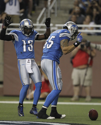 DETROIT - AUGUST 27:  Tony Scheffler #85 of the Detroit Lions celebrates with teammate Nate Burleson #13 after scoring a second quarter touchdown during the game against the New England Patriots at Ford Field on August 27, 2011 in Detroit, Michigan. The L
