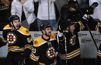 BOSTON, MA - MAY 27:  Adam McQuaid #54, Daniel Paille #20 and Tyler Seguin #19 of the Boston Bruins celebrate their 1 to 0 victory over the Tampa Bay Lightning in Game Seven of the Eastern Conference Finals during the 2011 NHL Stanley Cup Playoffs at TD G