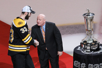 BOSTON, MA - MAY 27:  Deputy Commissioner Bill Daly shakes the hand of Zdeno Chara #33 of the Boston Bruins as he presents them The Prince of Wales trophy after they defeated the Tampa Bay Lightning 1 to 0 in Game Seven of the Eastern Conference Finals du