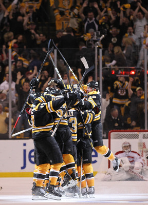 BOSTON, MA - APRIL 27: Nathan Horton #18 of the Boston Bruins celebrates with teammates after he scored the winning goal in overtime against the Montreal Canadiens in Game Seven of the Eastern Conference Quarterfinals during the 2011 NHL Stanley Cup Playo