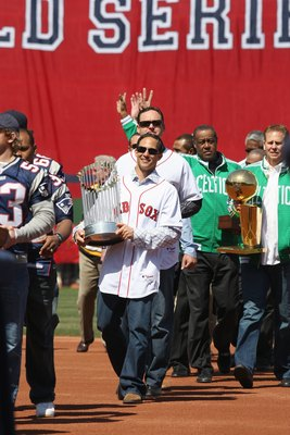 BOSTON - APRIL 08: Former Boston Bruins, Celtics and New England Patriot players walk in from center field before the start of the game between the Boston Red Sox and the Detroit Tigers on April 8,2008 during Opening Day at Fenway Park in Boston, Massachu