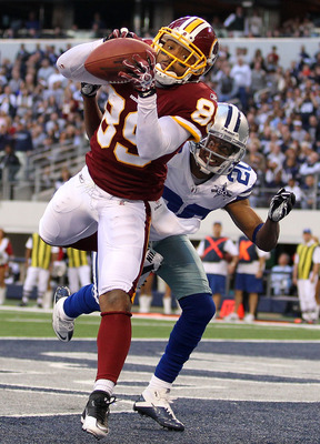 ARLINGTON, TX - DECEMBER 19:  Wide receiver Santana Moss #89 of the Washington Redskins makes a touchdown pass reception against Alan Ball #20 of the Dallas Cowboys at Cowboys Stadium on December 19, 2010 in Arlington, Texas.  (Photo by Ronald Martinez/Ge