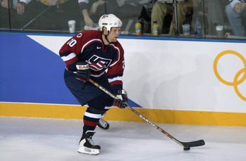 24 Feb 2002:    Gary Suter #20 of the USA plays the puck during the men's gold medal game at the Salt Lake City Winter Olympic Games at the E Center in Salt Elsa Hasch/Getty Images