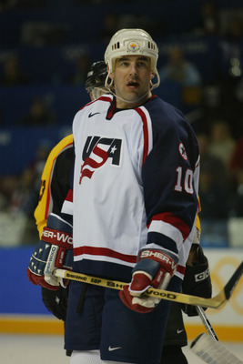 SALT LAKE CITY - FEBRUARY 20:  John LeClair #10 of the USA looks on from the ice against Germany during the game at the Salt Lake City Winter Olympics at the E Center in Salt Lake City, Utah. (Robert Laberge/Getty Images)