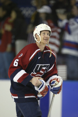 SALT LAKE CITY-FEBRUARY 22: Phil Housley #6 of the USA celebrates after defeating Russia 3-2 in the men's ice hockey semifinal during the game at the Salt Lake City Winter Olympic at the E Center in Salt Lake City, Utah on February 22, 2002. (Photo by Bri
