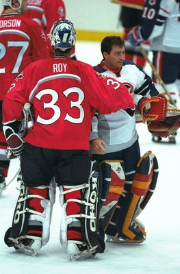16 Feb 1998:  Patrick Roy of Canada consols John Vanbiesbrouck of the USA during the 1998 Winter Olympic Games in Nagano, Japan. Canada won 4-1. Mandatory Credit: Brian Bahr /Allsport