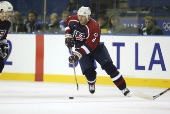 22 Feb 2002:   Mike Modano #9 of the USA brings the puck into the Russian zone during the men's semifinals at the Salt Lake City Winter Olympic Games at the E Center in Salt Lake City, Utah. DIGITAL IMAGE. Mandatory Credit:   Brian Bahr/Getty Images