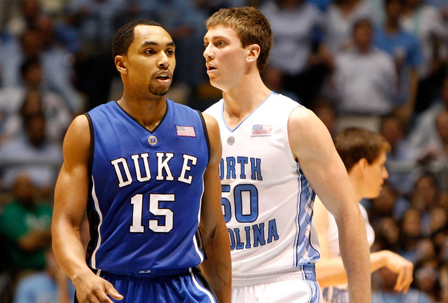 CHAPEL HILL, NC - MARCH 08:  Gerald Henderson #15 of the Duke Blue Devils walks by Tyler Hansbrough #50 of the North Carolina Tar Heels during their game at the Dean E. Smith Center on March 8, 2009 in Chapel Hill, North Carolina.  (Photo by Streeter Leck
