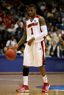 DAYTON, OH - MARCH 22:  Terrence Williams #1 of the Louisville Cardinals handles the ball against the Siena Saints during the second round of the NCAA Division I Men's Basketball Tournament at the University of Dayton Arena on March 22, 2009 in Dayton, Oh
