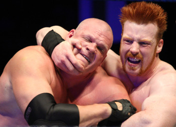 DURBAN, SOUTH AFRICA - JULY 08:  The Celtic Warrior Sheamus locks up with the Big Red Monster Kane during the WWE Smackdown Live Tour at Westridge Park Tennis Stadium on July 08, 2011 in Durban, South Africa.  (Photo by Steve Haag/Gallo Images/Getty Image