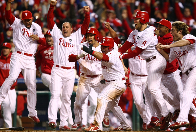 PHILADELPHIA - OCTOBER 19:  Carlos Ruiz #51 of the Philadelphia Phillies celebrates with his teammates after he scored the winning run on a walkoff 2-run double by Jimmy Rollins #11 against the Los Angeles Dodgers in Game Four of the NLCS during the 2009
