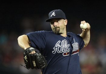 PHOENIX, AZ - MAY 18:  Relief pitcher George Sherrill #52 of the Atlanta Braves pitches against the Arizona Diamondbacks during the Major League Baseball game at Chase Field on May 18, 2011 in Phoenix, Arizona.  The Diamondbacks defeated the Braves 5-4 in