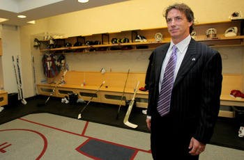 DENVER - OCTOBER 01:  Joe Sakic leaves the locker room of the Colorado Avalanche one last time, with his stall (L) permanently enshrined, on the night when Sakic's jersey was retired at the Pepsi Center on October 1, 2009 in Denver, Colorado.  (Photo by D