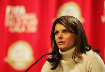 ZURICH, SWITZERLAND - DECEMBER 20: Mia Hamm of USA talks to the media before the FIFA Centenial World Player Gala 2004 at the Zurich Opera House on December 20, 2004 in Zurich, Switzerland.  (Photo by Shaun Botterill/Getty Images)
