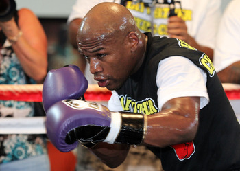 LAS VEGAS, NV - SEPTEMBER 06:  Floyd Mayweather hits the pads in the ring during his workout training session at his gym on September 6, 2011 in Las Vegas, Nevada.  (Photo by Jeff Bottari/Getty Images)