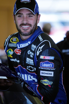 HAMPTON, GA - SEPTEMBER 02:  Jimmie Johnson, driver of the #48 Lowe's Chevrolet, climbs in his car during practice for the NASCAR Sprint Cup Series AdvoCare 500 at Atlanta Motor Speedway on September 2, 2011 in Hampton, Georgia.  (Photo by Todd Warshaw/Ge