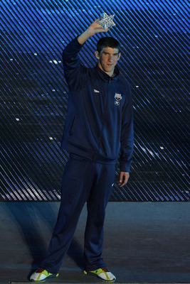 SHANGHAI, CHINA - JULY 31:  Michael Phelps of the United States takes part in the closing ceremony of the 14th FINA Swimming World Championships at the Crescent Lagoon Outdoor Diving Pool in Shanghai, China, Sunday, July 31, 2011.  (Photo by Feng Li/Getty