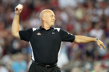 PHOENIX, AZ - JULY 11:  Hall of Famer Cal Ripken Jr. throws out the first pitch for the 2011 State Farm Home Run Derby at Chase Field on July 11, 2011 in Phoenix, Arizona.  (Photo by Christian Petersen/Getty Images)