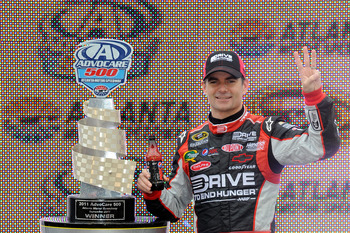 HAMPTON, GA - SEPTEMBER 06:  Jeff Gordon, driver of the #24 Drive to End Hunger Chevrolet, celebrates in victory lane after winning the NASCAR Sprint Cup Series AdvoCare 500 at Atlanta Motor Speedway on September 6, 2011 in Hampton, Georgia.  (Photo by Jo