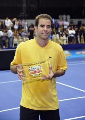 NEW YORK, NY - AUGUST 25:  Tennis player Pete Sampras poses with his trophy during an exhibition match at the DIRECTV Old School Challenge Presented by ESPN at the 69th Regiment Armory on August 25, 2011 in New York City.  (Photo by Mike Coppola/Getty Ima