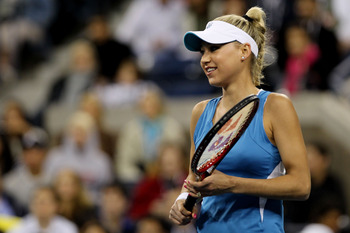 NEW YORK - SEPTEMBER 09:  Anna Kournikova looks on during her match against Pat Cash and Mats Wilander during day eleven of the 2010 U.S. Open at the USTA Billie Jean King National Tennis Center on September 9, 2010 in the Flushing neighborhood of the Que