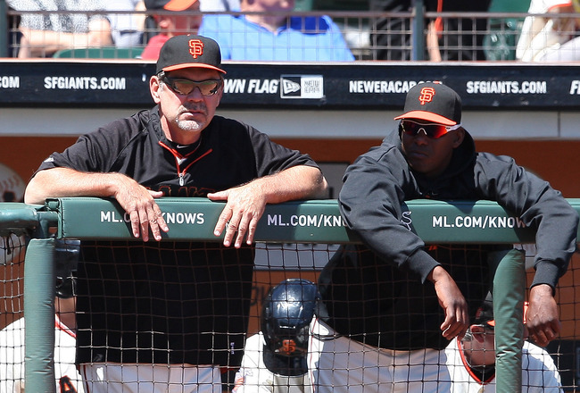 SAN FRANCISCO, CA - AUGUST 28: Bruce Bochy #16 of the San Francisco Giants and Hensley Meulens #31 of the San Francisco Giants talk in the dugout during a game between the Houston Astros and the San Francisco Giants at AT&T Park on August 28, 2011 in San