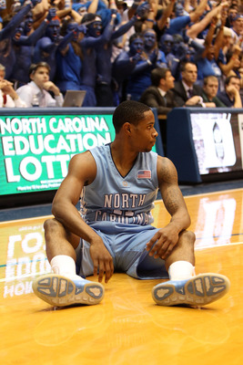 DURHAM, NC - MARCH 06:  Larry Drew II #11 of the North Carolina Tar Heels reacts to a call against during their game against the Duke Blue Devils at Cameron Indoor Stadium on March 6, 2010 in Durham, North Carolina.  (Photo by Streeter Lecka/Getty Images)
