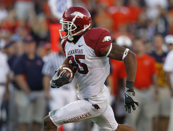 AUBURN - OCTOBER 16:  Wide receiver Greg Childs #85 of the Arkansas Razorbacks makes a reception and runs for a touchdown in the fourth quarter during the game against the Auburn Tigers at Jordan-Hare Stadium on October 16, 2010 in Auburn, Alabama.  The T