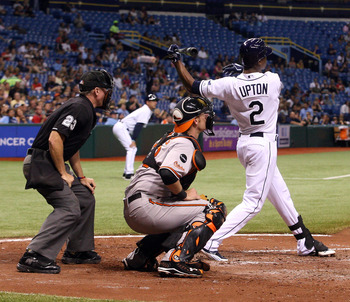 ST. PETERSBURG, FL - SEPTEMBER 03:  B.J. Upton #2 of the Tampa Bay Rays hits a double with bases loaded against the Baltimore Orioles during the game on September 03, 2011 at Tropicana Field in St. Petersburg, Florida. The Tampa Bay Rays defeated the Balt