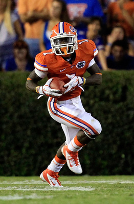 GAINESVILLE, FL - SEPTEMBER 03:  Chris Rainey #1 of the University of Florida Gators runs for yardage during a game against the Florida Atlantic University Owls at Ben Hill Griffin Stadium on September 3, 2011 in Gainesville, Florida.  (Photo by Sam Green
