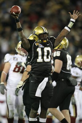 NASHVILLE, TN - DECEMBER 31:  Larry Smith #10 of the Vanderbilt Commodores celebrates against the Boston College Eagles during the Gaylord Hotels Music City Bowl at LP Field on December 31, 2008 in Nashville, Tennessee.  (Photo by Andy Lyons/Getty Images)