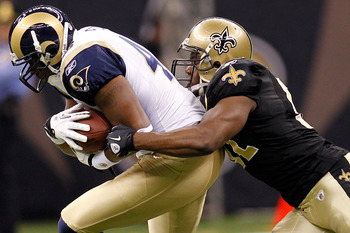 NEW ORLEANS, LA - DECEMBER 12:  Daniel Fells #46 of the St. Louis Rams is tackled by Jonathan Vilma#51 of the New Orleans Saints at the Louisiana Superdome on December 12, 2010 in New Orleans, Louisiana.  (Photo by Chris Graythen/Getty Images)