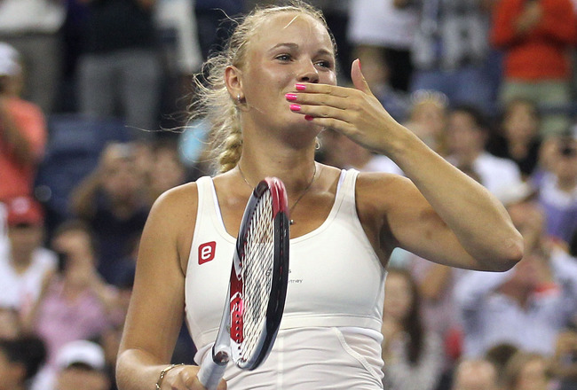 NEW YORK, NY - SEPTEMBER 05:  Caroline Wozniacki of Denmark celebrates winning the match against Svetlana Kuznetsova of Russia during Day Eight of the 2011 US Open at the USTA Billie Jean King National Tennis Center on September 5, 2011 in the Flushing ne
