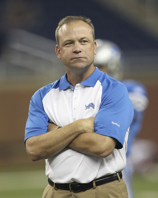 DETROIT - SEPTEMBER 02:  Detroit Lions offensive coordinator Scott Linehan watches the warms up prior to the start of the preseason game at Ford Field on September 2, 2010 in Detroit, Michigan. The Lions defeated the Bills 28-23.  (Photo by Leon Halip/Get