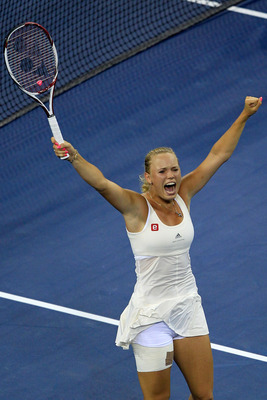 NEW YORK, NY - SEPTEMBER 05:  Caroline Wozniacki of Denmark celebrates winning match point against Svetlana Kuznetsova of Russia during Day Eight of the 2011 US Open at the USTA Billie Jean King National Tennis Center on September 5, 2011 in the Flushing